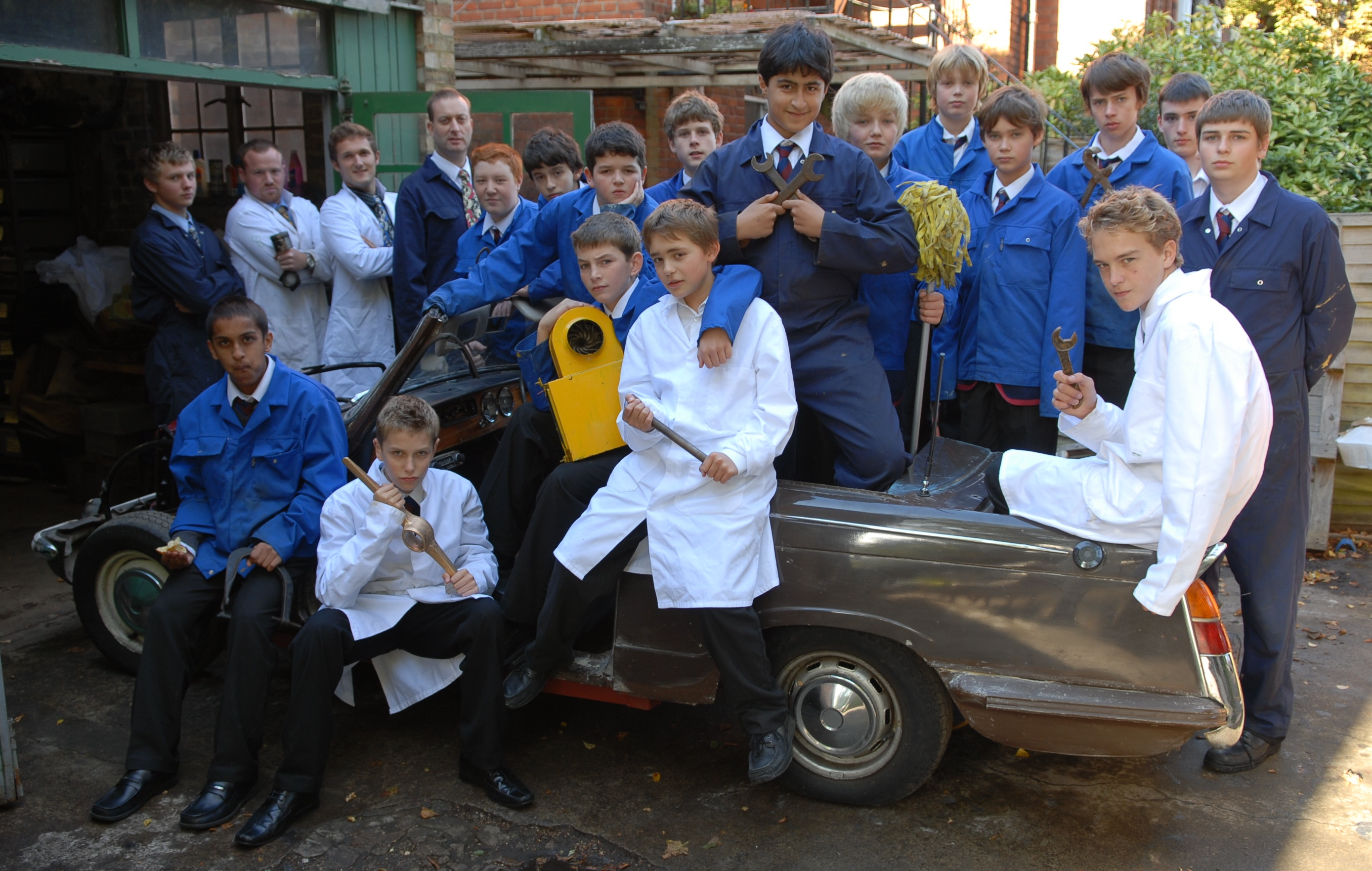 Highgate students fixing a car