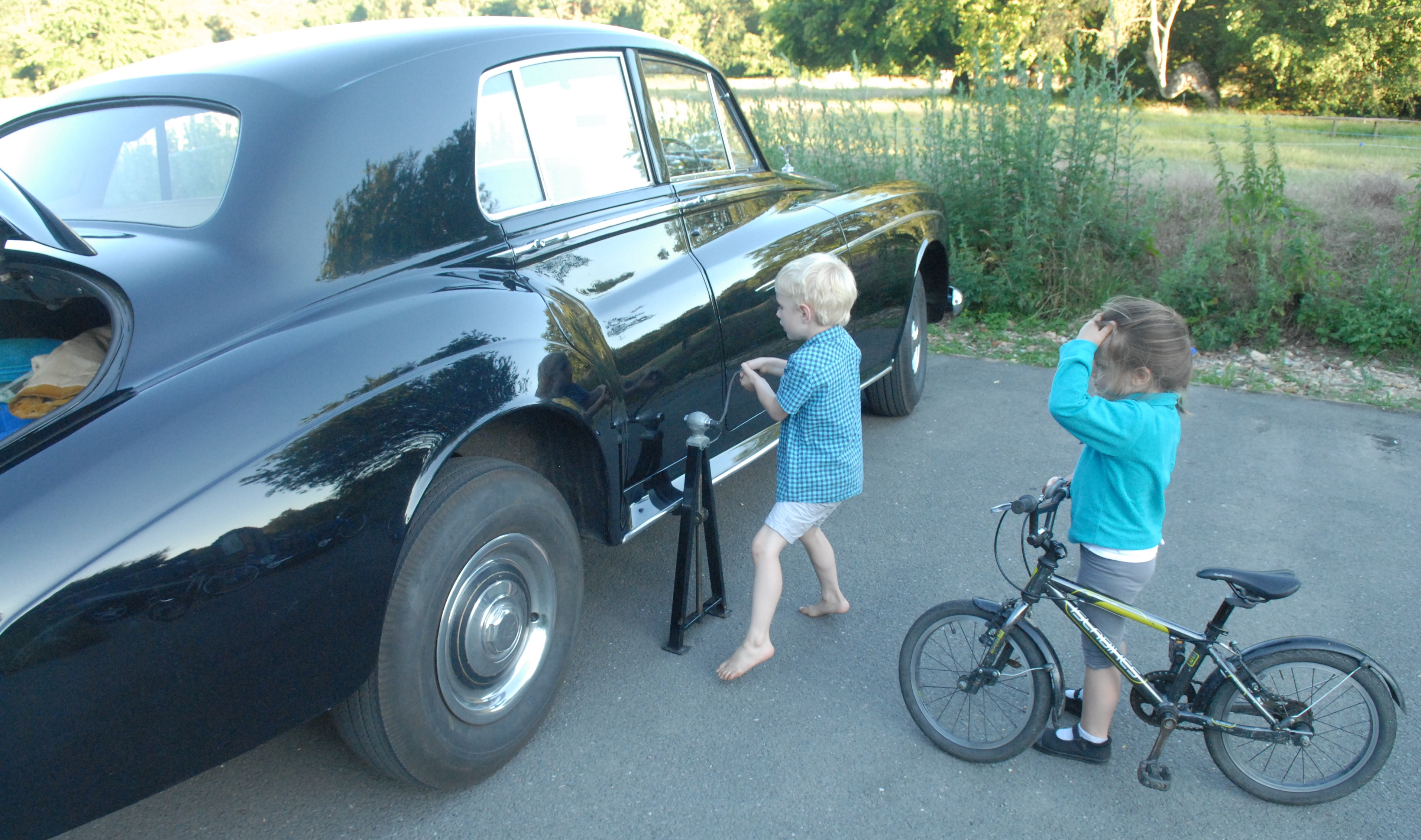 Children with a Rolls Royce